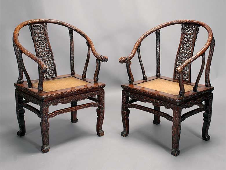 A Pair of Carved Huanghuali and Mixed Wood Horseshoe Chairs, 16th/17th Century Elements